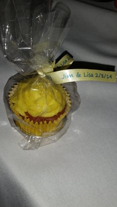 Yellow cupcakes made by my 13 year old daughter. Ribbon from eBay