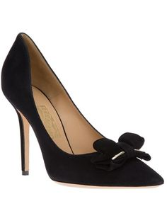 SALVATORE FERRAGAMO Pointed Toe Pump - $509 Black suede pumps from Salvatore Ferragamo featuring a pointed toe, a bow with gold-tone details at the front, a shallow opening and a covered stiletto heel.