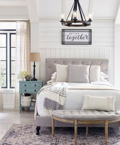 Get the look of a bespoke designer bedroom with an exquisite queen-upholstered bed covered in crisp light gray linen. #lowes #farmhouse #masterbedroom