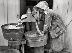 "May 1938. Irwinville Farms, Georgia. ""Mrs. Coleman doing a washing."""