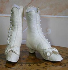 c. 1871, white leather boots, bustle era. White leather boots were most commonly used by the upper middle/upper classes for wedding attire.