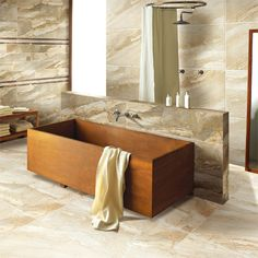 A large luxurious bathroom featuring Porcel-Thin EPHESUS ultra-thin 1200 x marble effect porcelain tiles with a wooden free standing bath and wetroom Latest Bathroom Designs, Bath Tiles, Room Tiles, Minimalist Bathroom Design, Wall And Floor Tiles, Material Design, Tile Design, Luxury Interior, Design Trends