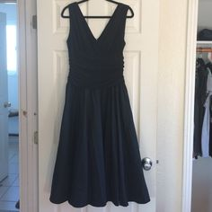 "LOWEST: Jessica Howard LBD Plunge neckline little black dress. Zipper in the back. Polyester/Spandex. Picture 3 is lightened to show detail. Lined and a bit of tulle to flare the skirt out a bit. Super cute vintage look. I'm 5'11"" and its hits just below my knees. Willing to negotiate price, make an offer!! Rough flat measurements: 18 inches pit to pit, 16 inches waist, 18 inches shoulder to waist, 28 inches waist to hem, roughly 46 inches shoulder to hem. Jessica Howard Dresses"