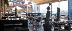 In the summer, Le Place d'Armes Hotel & Suites hosts the city's hottest open-air rooftop bar and restaurant with a trendy ambiance and breathtaking views of Old Montreal, Notre Dame Basilica and the Mont-Royal.