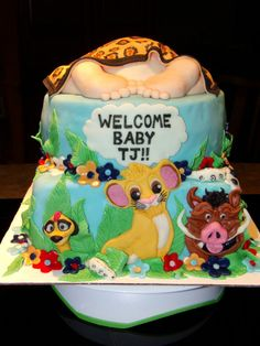 Simba - Lion King Baby Shower cake with baby's butt covered with blanket