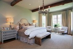 Great mix of styles...love the bench at the foot of the bed and the over-sized night stands/chests. We are doing a similar layout with our furniture right now with slipper chairs and a round scroll work table in front of the windows
