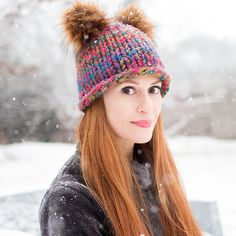 Get the designer look for less with this free knit beanie pattern. You can knit a hat in no time with this fun design featuring two fluffy pom poms on top.