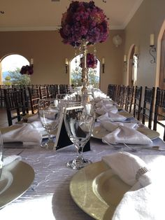 Wedding table set up! Flowers balls! Purple and pink!! Napkins in a bow with bling napkin rings!!!