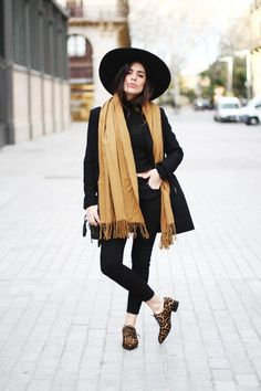 Shop this look on Lookastic:  https://lookastic.com/women/looks/shawl-trenchcoat-turtleneck-skinny-jeans-oxford-shoes-hat/6445  — Black Wool Hat  — Tan Shawl  — Black Turtleneck  — Black Trenchcoat  — Black Skinny Jeans  — Brown Leopard Leather Oxford Shoes