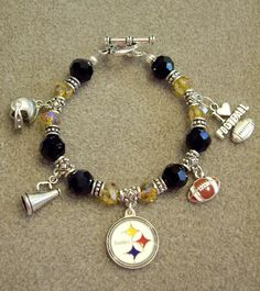 Items similar to Pittsburgh Steelers NFL Dangle Charm Bracelet with Swarovski Black & Gold Crystals on Etsy Steelers Gear, Pittsburgh Steelers Football, Pittsburgh Sports, Steelers Stuff, Team Spirit Crafts, Pitt Panthers, Football Fashion, Steeler Nation, Dangles