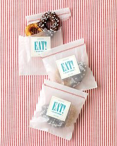 Give guests a sweet treat such as these sourdough pretzels dipped in chocolate, wrapped in glassine envelopes stitched closed with red thread.