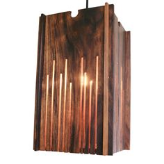 Bring natural and organic elements into your home's interior with our luminous walnut wood lamp, thoughtfully designed to be used for your table or as a hanging pendant light. The carved slats have a