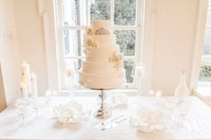 This classic cake table set up is elegant and classy. It just goes to show that you don't always need color to add excitement to your wedding decor.