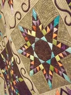 Love the colors on this feathered star quilt