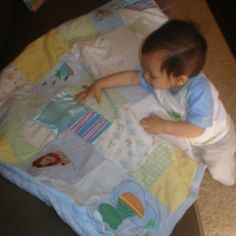 "Make a ""first year"" quilt out of onesies and outfits that are otherwise unusable that your baby wore their first year. I included pieces of each child's hospital blanket."