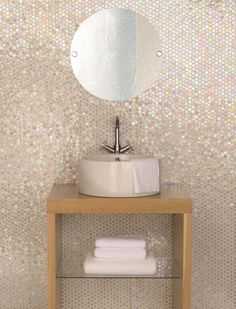 When a square is simply too straight edged, opt for these circular White Lady mosaics with their iridescent finish. By Original Style.