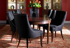 Black is in! First-class and sexy right?! I never knew a dining room set could look so suave, lol.     By, Lillian August Fine Furnishings