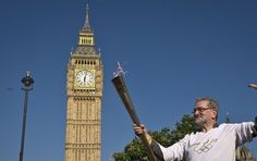 On the penultimate day of the Olympic Torch Relay Anthony Page holds the Flame in front of one of London's most popular landmark's, Big Ben, as it travels through the city of Westminster. Olympic Flame, Summer Games, Rio 2016, Westminster, Wonderful Places, 21st Century, Big Ben, Olympics, Britain