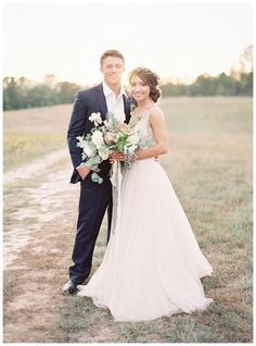Bride and groom on a country road. Bridal bouquet by Nectar. Image by Allison Kuhn Photography at The Ivy Place in Lancaster, SC.