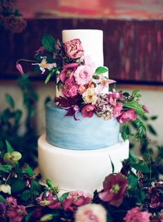 Garden inspired four tier white and soft blue wedding cake wrapped in bold florals: http://www.stylemepretty.com/2016/10/03/art-deco-inspo-that-brings-the-outdoors-in/ Photography: Kayla Barker - http://kaylabarker.com/