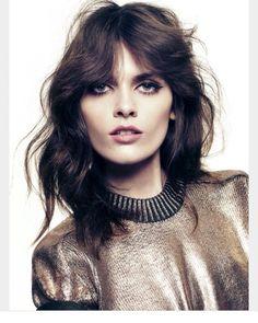 Rocker glam shag hair layers dark makeup
