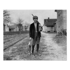 A boy returns home from rabbit hunting. Dillon, South Carolina. 1909.
