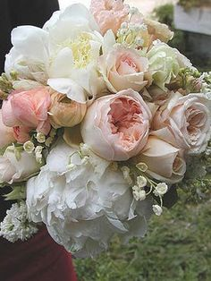 how dang romantic is this bouquet? peonies, lily of the valley, shades of light pink roses, hyacinth, and white stock.  GORGEOUS