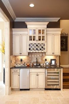 Wet bar: wine fridge and ice machine a must for entertaining. **Idea for bar drink area in kitchen Basement Kitchen, New Kitchen, Kitchen Small, Kitchen Bars, Rustic Basement, Modern Basement, Kitchen Pantry, Kitchen Sink, Home Inc