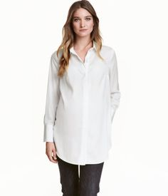 White. Shirt in woven fabric with a turn-down collar. Concealed pearlescent buttons at front, metal button at neck, and long sleeves with wide cuffs, slit,