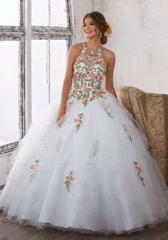 Organza Quinceañera Dress with Ruffle Skirt. Beaded Bodice with Sweetheart Neckline. Corset Back. Colors Available: Light Aqua, Coral, Champagne, White
