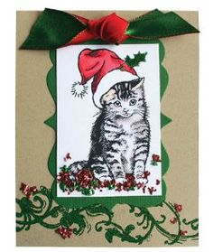 To make a handmade Christmas craft that's the real cat's meow, create a Christmas Kitty Card. This adorable Christmas card will warm the heart of whoever receives it, and you'll have the materials to create it again and again. There's nothing more perfect for an animal lover this Christmas than an adorable kitty cat card!