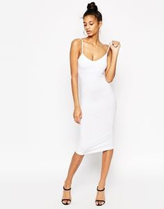 White midi dress that would be perfect for a daytime look during bachelorette weekend.