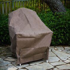 Smart and durable, the KoverRoos KoverRoos III Taupe High Back Chair Cover is a great way to protect your patio furniture investment. This cover. Fire Pit Table And Chairs, Balcony Table And Chairs, Outdoor Furniture Covers, High Back Chairs, Furniture Dolly, Furniture Companies, Taupe, Ottoman, Outdoor Decor