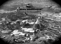 Helicopter fly in to Disneyland.