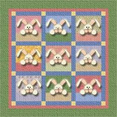 Sleeping Bunnies Quilt | Appropriate for the Easter season, these little bunnies will delight the wee ones all year long! Make this easy crib-sized quilt or add more blocks for a bigger quilt!