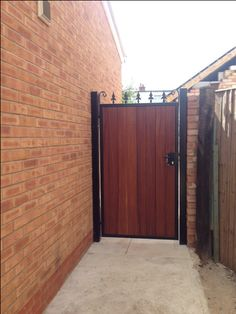 "Garden gates and side gates from our ""Middleton"" collection. Adds security and privacy whilst keeping its stunning gate appearance. Deep metal frame powder coated black combined with the finest iroko hardwood."