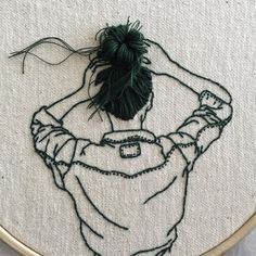 Fashion model and embroidery artist Sheena Liamhand sews images of women whose hair seems to gracefully danglefrom each of her 2D surfaces, Liam using black thread as a substitute for her subjects' long locks. The works are all completed and displayed on embroidery hoops, with hair styles extendin