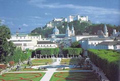 Salzburg - Mirabel Palace garden with Hohensalzburg Castle in the distance.