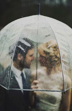 Rainy day wedding portraitsfrom Gray Skies - Glowing Winter Wedding Inspiration in Gray and Blush: