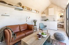 Modern living room by ÁBATON (smart use of a small space; great natural light)