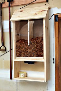 """step by step instructions on how to build a dog food dispenser that is mounted on the wall and uses a """"blast gate"""" Pet Food Storage, Food Storage Containers, Storage Bins, Dog Food Container, Dog Rooms, Dog Daycare, Pet Life, Dog Crate, Puppies Tips"""