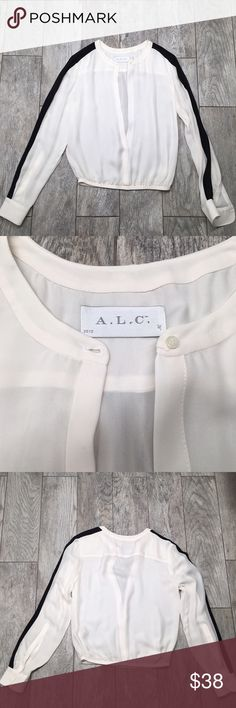 A.L.C. Silk black and white 100% silk top blouse 100% silk A.L.C. black and white blouse. EUC. Elastic bottom. Button up front. No collar. Perfect with a pencil skirt A.L.C. Tops Blouses