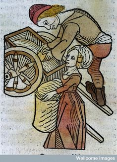 A man and a woman loading a cart, woodcut,1547