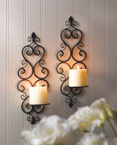 """Candleholders & Candles Home Locomotion This dazzling duo of candle sconces will dress up any wall with continental style and flair. Just add pillar candles, and the intricate scrolling metalwork design of this sconce set will shine! Item weight: 1.4 lbs. Each is 5 1/2"""" x 4 3/8"""" x 15 3/4"""" high. Iron. Candles not included. Pair UPC: 849179016944."""
