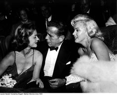 "Lauren Bacall, Humphrey Bogart & Marilyn Monroe at the premiere for ""How to Marry a Millionaire""."