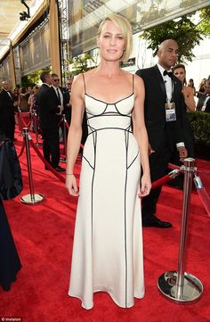 Right in white! Robin Wright looked absolutely sensational as she hit the red carpet at the 67th Primetime Emmy Awards on Sunday