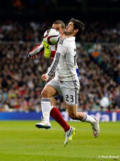 Isco of Real Madrid in action against Mario Suárez of Atlético de Madrid during the Copa del Rey round of 16 second leg match between Real Madrid and Atletico de Madrid at Estadio Santiago Bernabeu on January 15, 2015 in Madrid, Spain.