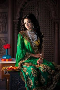 green lehenga with jewellery. Nath and pearl necklace