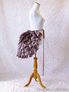 This would be perfect in Black, i like the idea of a simple over bustle   Steampunk Edwardian Bustle. by CostumeCollective on Etsy, $65.00