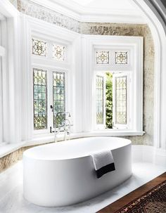 The minimal Boffi bathtub in the ensuite of this Sydney home by Hancock Architects sits in front of a wall of convict-worked sandstone and stained-glass windows. From Belle November Bathroom Windows, Glass Bathroom, Bathroom Ideas, Bathroom Organization, Bath Ideas, Bathroom Faucets, Bathroom Mirrors, Bathroom Cabinets, Bathroom Storage
